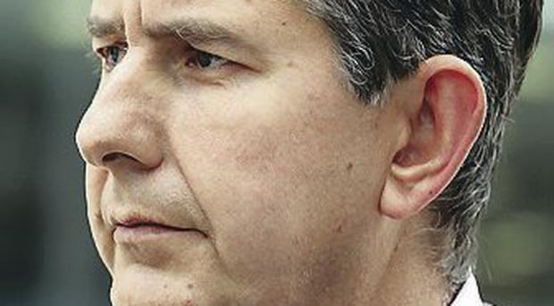 Health Minister Edwin Poots is facing increased pressure