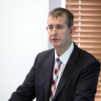 Mr Justice Treacy said that Health Minister Edwin Poots (pictured) breached the ministerial code by failing to take the issue before the Stormont Executive