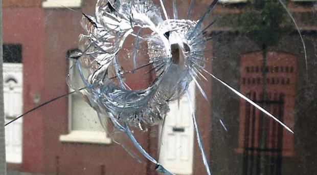 The crossbow bolt punched a hole in a window and embedded in a toaster – just missing the resident