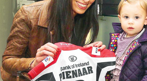 Ruan Pienaar's wife Monique picks up a shirt for 16-month-old daughter Lemay