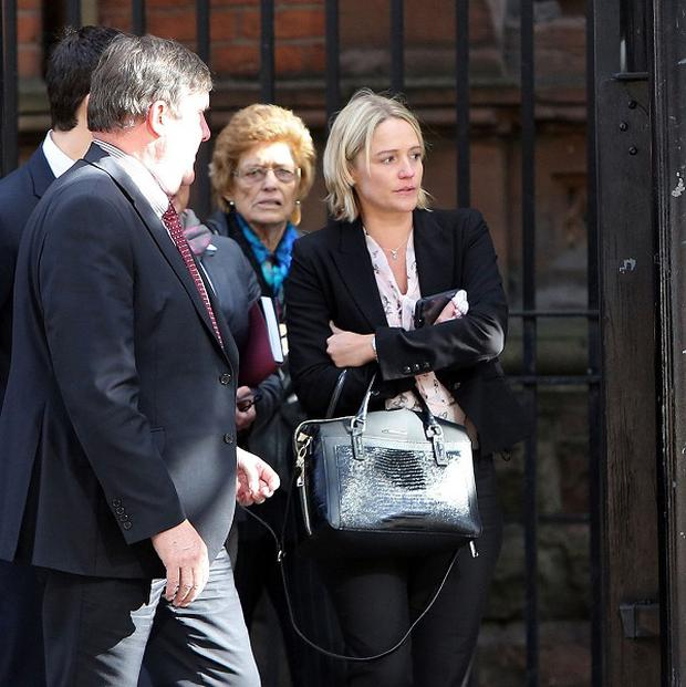 Samatha Bennett, the mother of 20-month-old Liam Gonzales Bennett, leaves court with family and legal representatives after an inquest into his death at the Coroners' court, Belfast.