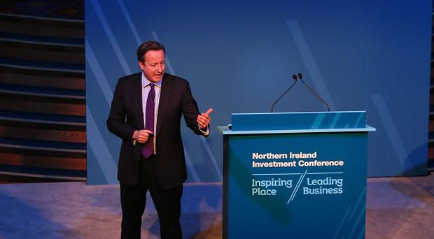 Prime Minister David Cameron speaking at the Invest Northern Ireland investment conference at the Titanic Belfast