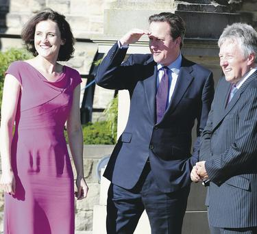 Prime Minister David Cameron with Secretary of State Theresa Villiers and First Minister Peter Robinson at Stormont Castle