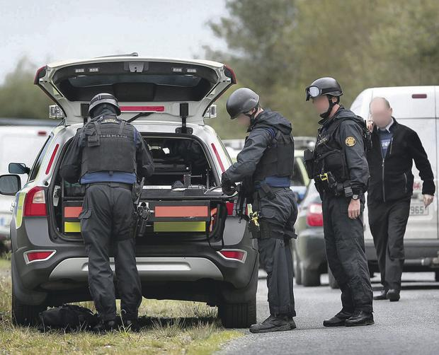 Members of the Garda Armed Support Unit on the Brae Road close to Burnfoot in Co Donegal as the search for fugitive Kieran McLaughlin continues.