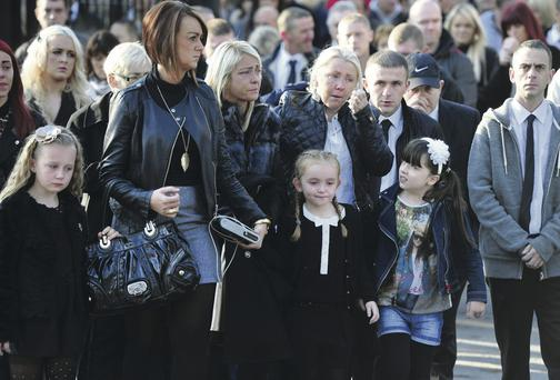 Relatives at the funeral of Belfast man Kevin Kearney who was shot dead in North Belfast last week