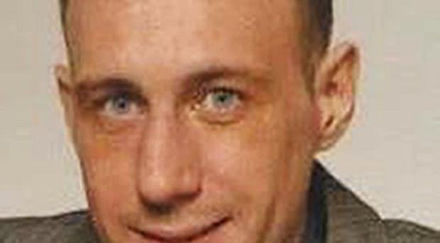 Barry McCrory, 35, who was gunned down in a flat in Londonderry city centre