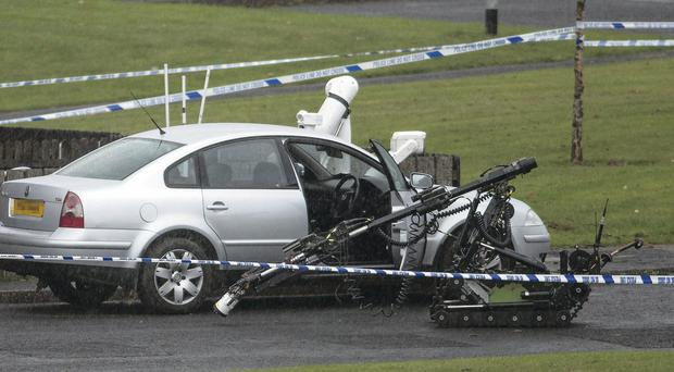 An Army robot examines a car at Ederowen Park in Galliagh