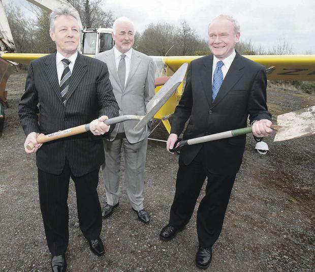 First ministers Peter Robinson and Martin McGuinness with Long Kesh Development Corporation chairman Terence Brannigan (centre) at the launch of the Maze prison peace centre project in April 2013