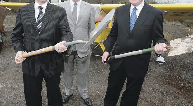 First ministers Peter Robinson and Martin McGuinness with Long Kesh Development Corporation chairman Terence Brannigan (centre) at the launch of the Maze prison peace centre project