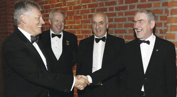 First Minister Peter Robinson (left) is welcomed by Tyrone manager Mickey Harte (right), with the chairman of Ulster GAA Martin McAviney (second left) and the secretary of Ulster GAA Danny Murphy