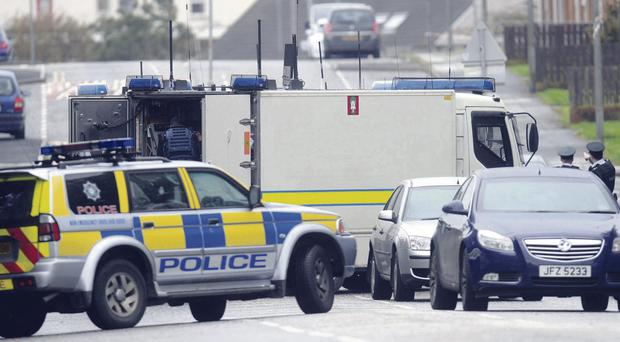 Police and Army bomb experts at Sloan Street, Lurgan, yesterday after Ceara Special School and Carrick Primary were forced to close. Photo: Pacemaker