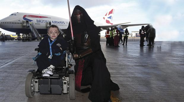 Ryan Shannon (left) and new pal before boarding the British Airways Dreamflight plane to Florida