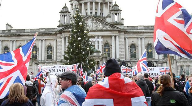 Protests over the flying of the Union flag plagued Belfast in the run-up to Christmas last year
