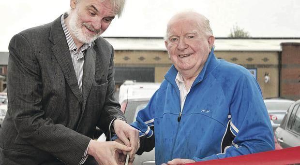 Comedian Tim McGarry cuts the ribbon to officially open the Men's Shed in north Belfast