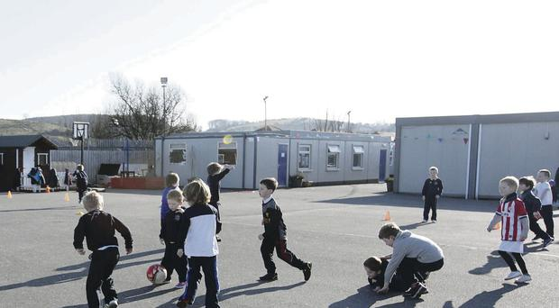 Pupils play outside at Drumlins Integrated Primary School