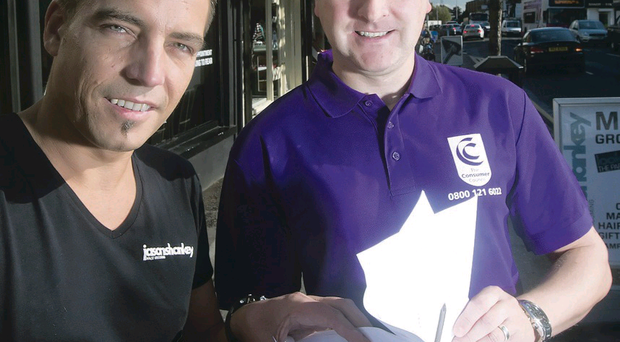 Jason Shankey (left) with Mark Crawford, head of consumer support at the Consumer Council, after resolving his dispute with NI Water