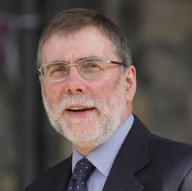 Nelson McCausland said the pilot programme 'will allow us to try out a range of initiatives to see what works best and what could work in other places too'