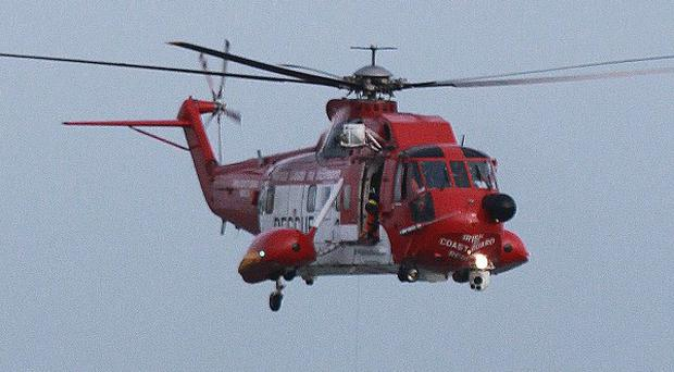 Two tourists had to be rescued by an Irish coastguard helicopter from cliffs near Ballycastle