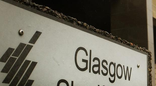 Five people have been charged with terrorism offences at Glasgow Sheriff Court