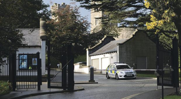 Police stand at a security gate at Stormont Castle after yesterday's letter bomb