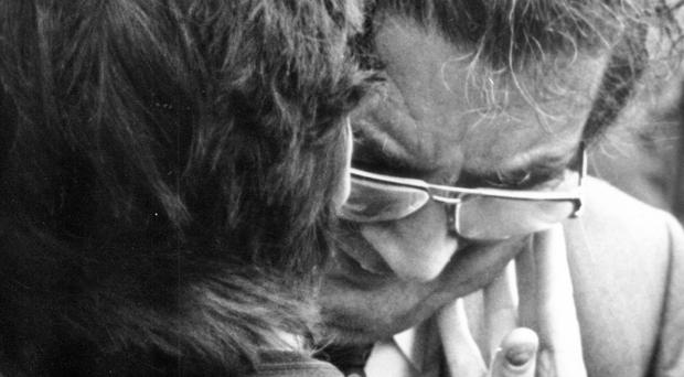 SDLP leader John Hume is comforted as he weeps at the funerals
