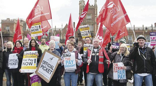 University staff at Queen's University in Belfast hold a picket outside the main building during a one-day strike over pay