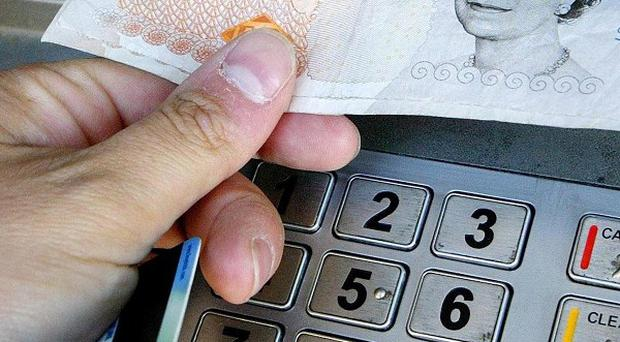 Two men have been charged over theft of money from ATM machines