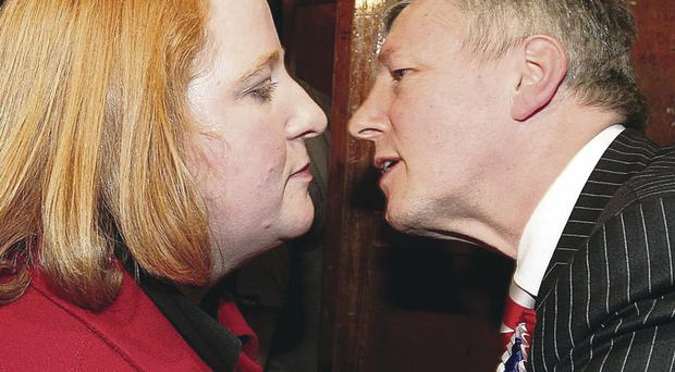 First Minister and DUP leader Peter Robinson congratulates Naomi Long of Alliance after she unseated him in East Belfast in 2010