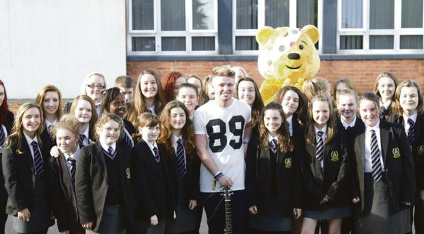 X Factor star Jordan O'Keefe with the Priory College singers and Pudsey