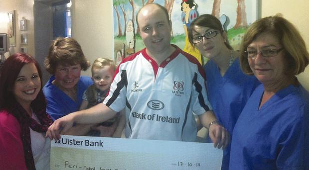 Thomas Moore and wife Katherine presenting the donation at the neo-natal clinic