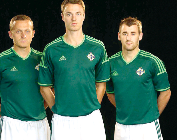 Sammy Clingan, Jonny Evans and Niall McGinn model the new Northern Ireland kit