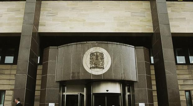 A sixth person has been charged and remanded under the Terrorism Act at Glasgow Sheriff Court (pictured)