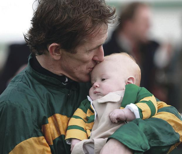 Tony McCoy kisses his son Archie