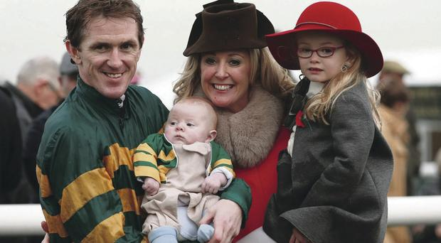 Tony McCoy with his daughter Eve, son Archie and wife Chanelle after his 4,000th victory