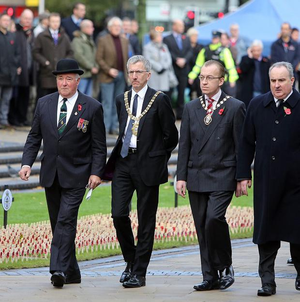 Mairtin O Muilleoir (second left), the Sinn Fein mayor of Belfast attends the Armistice Day service at the cenotaph at City Hall, Belfast