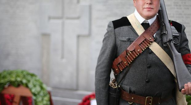 Steven Smith, dressed as a UVF volunteer, takes part in a cross-border wreath laying ceremony at the cenotaph in Glasnevin Cemetery in Dublin