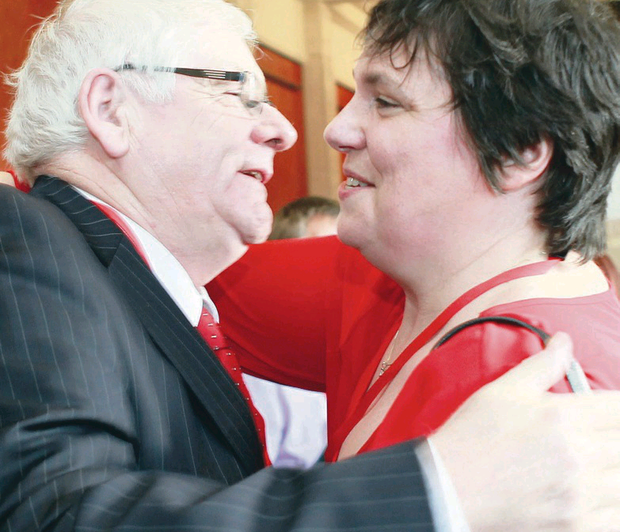 Michael Gallagher embraces Ann Travers at Stormont meeting