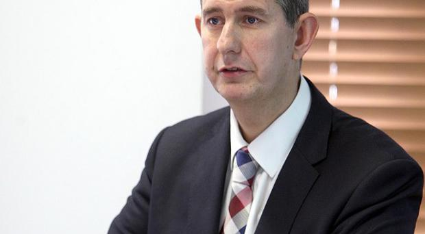 Health Minister Edwin Poots has defended his stance against adoption by gay couples.