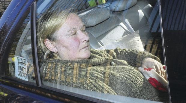 Olga Charlton was committed for trial in the back of a taxi outside Antrim Courthouse