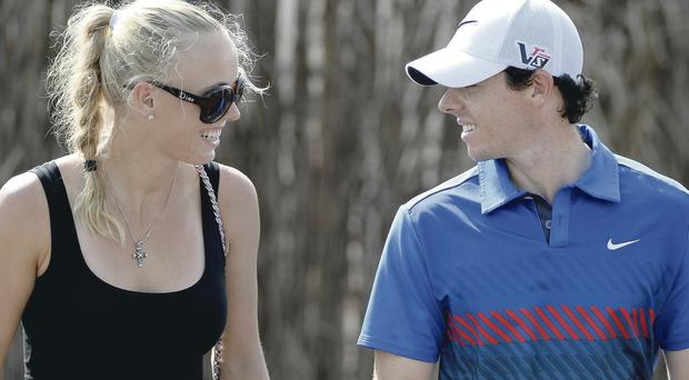 Caroline Wozniacki and Rory McIlroy after his first round in Dubai
