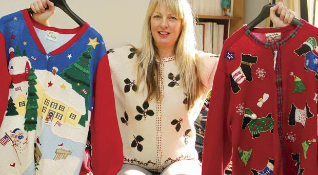 Designer Lisa McBride with some of her Christmas jumpers