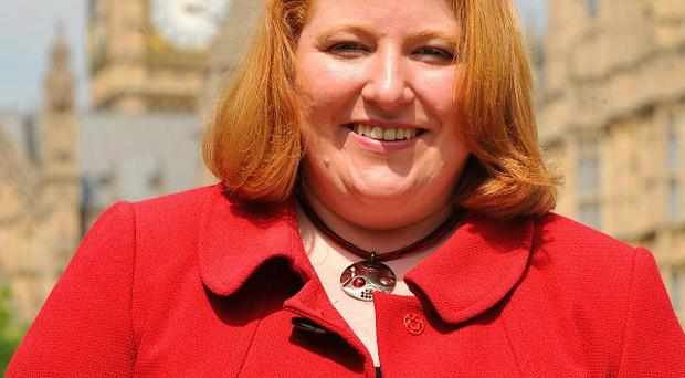 A man faces court over a bomb alert at the office of Alliance MP Naomi Long