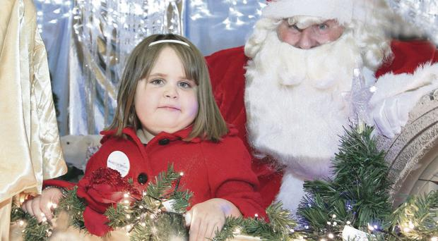Dream day: Hanna Ferjani visits Santa in his Grotto in Lisburn before her magical shopping experience for toys