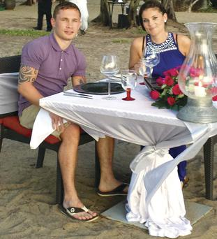 Carl and Christine have a meal on the beach in Thailand.