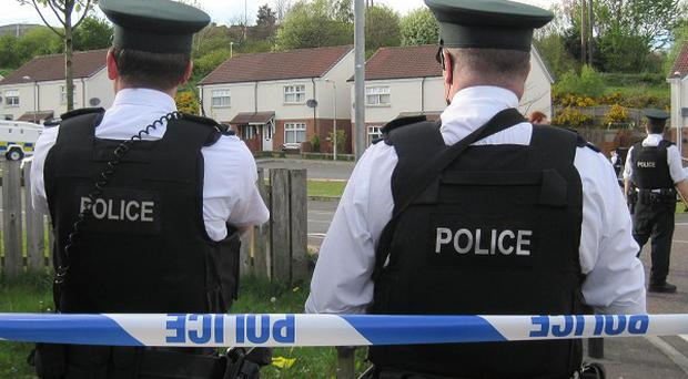 A pipe bomb has been found yards from a school playground in west Belfast