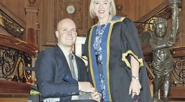 South Pole explorer Mark Pollock with Marie-Therese McGivern, chief executive of Belfast Metropolitan College after receiving the college's inaugural Honorary Fellowship Award
