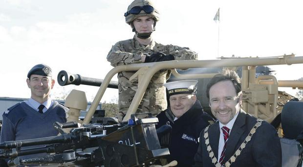 Mayor of Newtownards, Cllr Stephen McIlveen, joined Sergeant Martin Clarke, 502 (Ulster) Sqn, RAF(Auxilliary), WO2 Paul Cochrane and Able Seaman Mark McCleave, HMS Hibernia, to celebrate Ards being chosen to host the main event for Armed Forces Day next year
