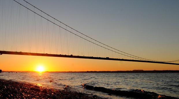 The sun rises behind the Humber Bridge near Hull, which has been named as the next UK City of Culture