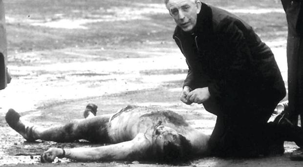 Fr Reid gives the last rites to David Howes, one of two soldiers killed by IRA after driving into a republican funeral in 1988 at a time of extreme tensions and ongoing violence