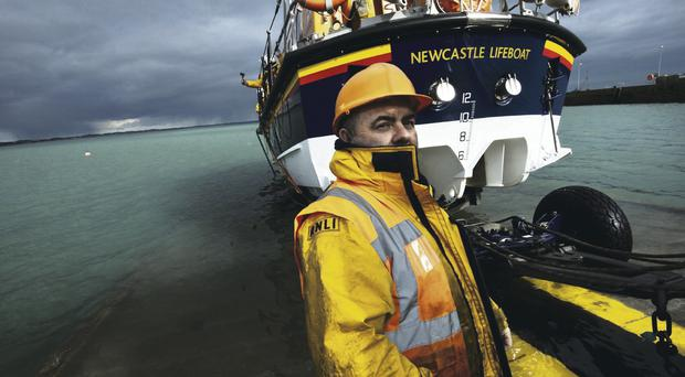 Joe Lenaghan, the Deputy Launching Authority for Newcastle Lifeboat, captured by photographer Nigel Millard in the RNLI's outdoor exhibition currently showing in Dublin